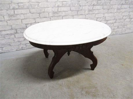 VINTAGE OVAL CARVED COFFEE TABLE WITH MARBLE TOP