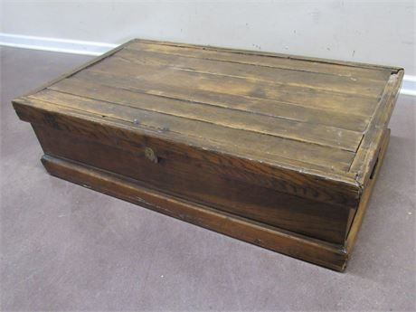 ANTIQUE TRUNK WITH DOVETAILED CORNERS AND WROUGHT IRON HANDLES