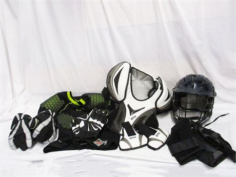 LOT OF LACROSSE EQUIPMENT FEATURING NIKE PRO COMBAT AND CASCADE