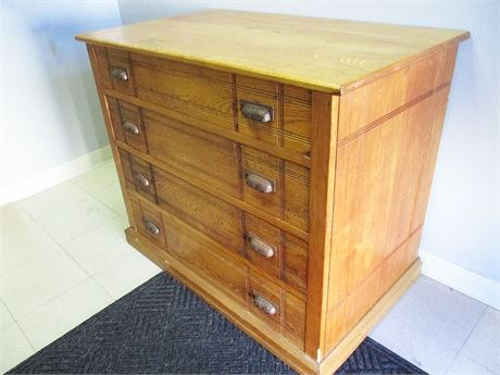 VINTAGE 4-DRAWER OAK CHEST WITH BRASS PULLS