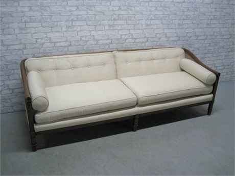 VINTAGE SOFA WITH WOOD TRIM AND CANE SIDES