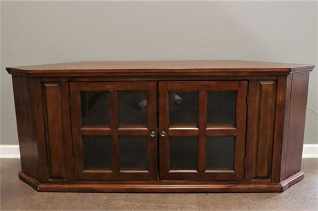 Angled Wood TV Console with glass doors in front