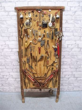 LARGE PEGBOARD WITH VINTAGE ITEMS - PINS BADGES KEY FOBS SKELETON KEYS & TOOLS