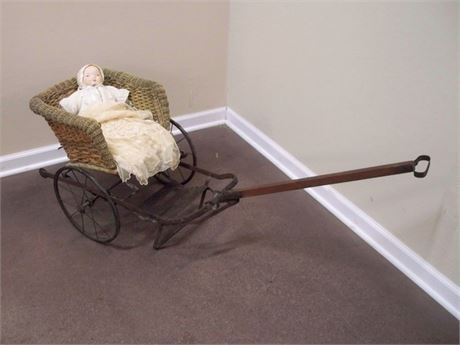 ANTIQUE METAL AND WICKER BABY PULL CART/CARRIAGE WITH VINTAGE DOLL