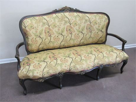 BEAUTIFUL ANTIQUE FLORAL UPHOLSTERED SETTE WITH WOOD ARMS AND TRIM
