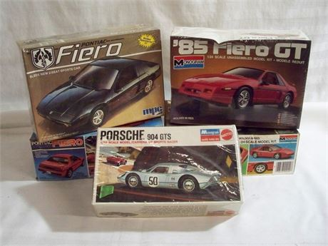 5 VINTAGE MODELS WITH BOXES - 4 FIERO'S AND A PORSCHE 904 GTS