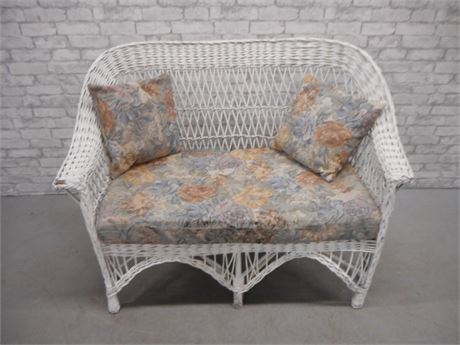 WHITE WICKER LOVESEAT WITH CUSHION AND 2 PILLOWS
