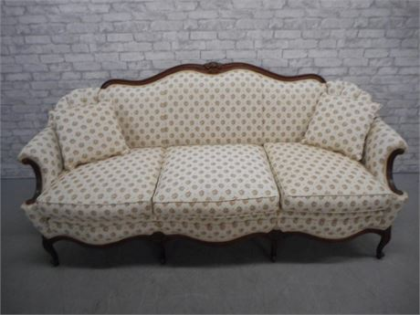 NICE FLORAL CAMEL BACK SOFA WITH WOOD TRIM