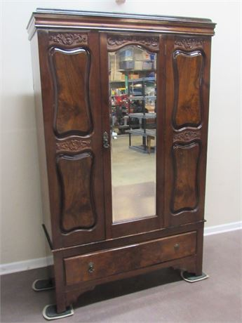 VINTAGE/ANTIQUE ARMOIRE WITH BEVELED GLASS MIRROR