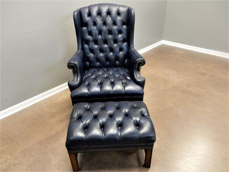 Navy Blue Genuine Leather Chair and Ottoman with Wood Legs and Nail Head Trim.