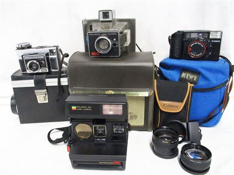LOT OF VINTAGE CAMERAS FEATURING CANON