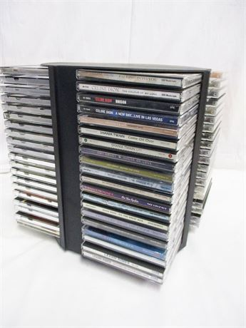 LOT OF 80 CDs AND CD STORAGE TOWER