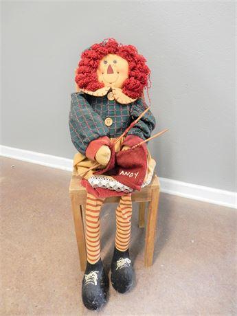 Large Raggedy Ann Doll Knitting on a Chair