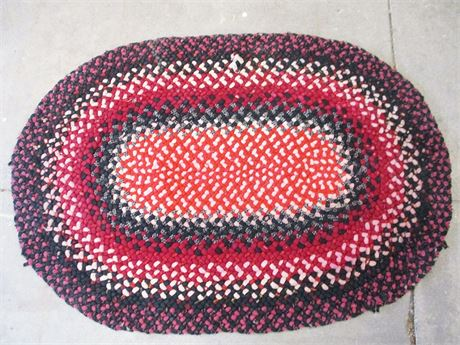 BLACK AND RED BRAIDED THROW RUG