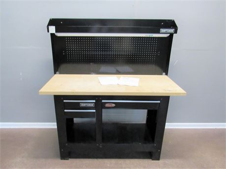 Craftsman Workbench with Metal Beg Board Back Wall and Light
