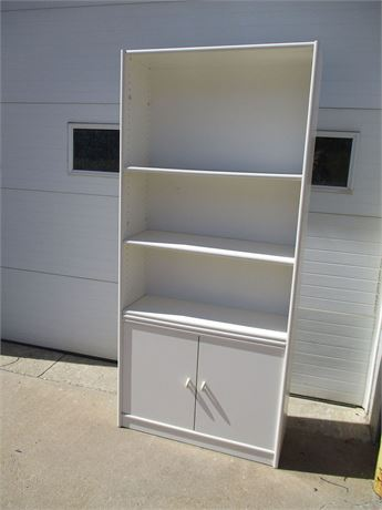 WHITE CABINET WITH CLOSED STORAGE