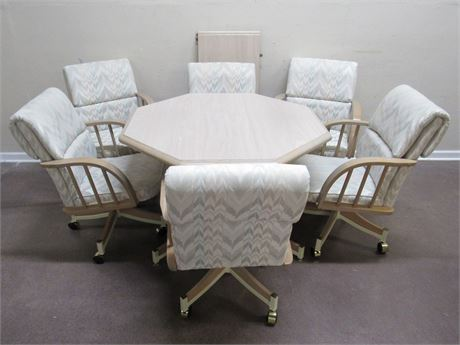 DINETTE TABLE WITH 6 UPHOLSTERED ARM CHAIRS ON CASTERS