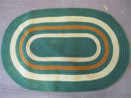 GREEN AND GOLD BRAIDED WOOL RUG