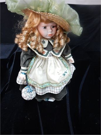 The Emerald Doll Collection Porcelain Doll