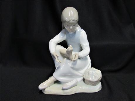Nao by Lladro -  Girl Seated Nurturing Bare Foot Figurine