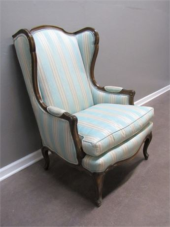 VINTAGE UPHOLSTERED STRIPED WING-BACK CHAIR WITH WOOD TRIM