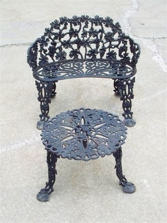 VINTAGE CAST IRON GRAPE VINE MOTIF GARDEN SETTEE AND TABLE