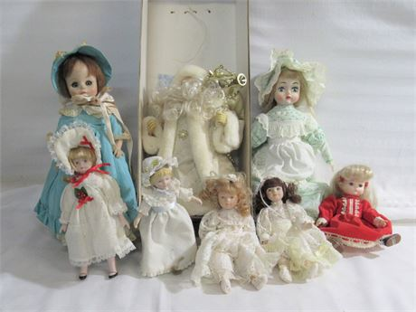 8 Piece Lot - 7 Dolls and a Santa Tree Topper
