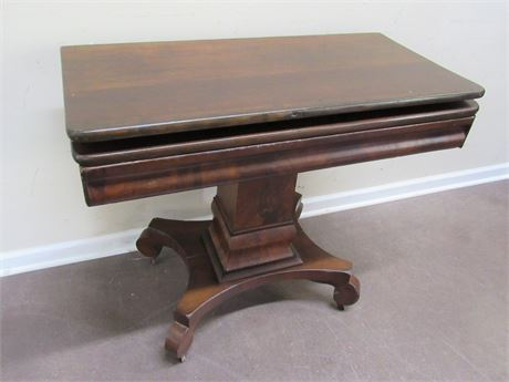 ANTIQUE PEDESTAL GAME TABLE ON CASTERS