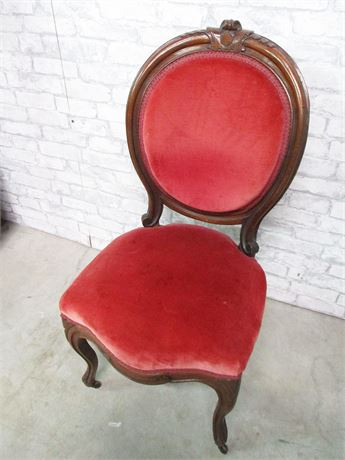 VINTAGE CARVED CHAIR WITH RED VELVET CUSHIONS