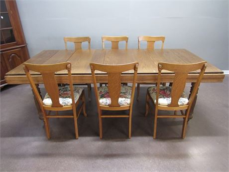 LARGE VINTAGE OAK DINING TABLE ON CASTERS WITH 8 CHAIRS