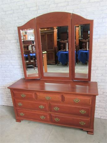 Nice Cherry Finished 7 Drawer Dresser with Beveled Glass Tri-fold Mirror