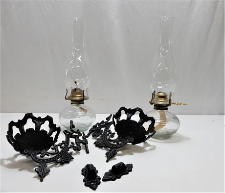 Two Vintage Cast Iron Sconces and Oil Lamp