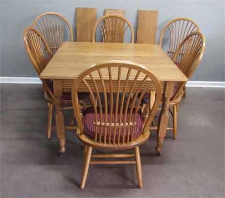 Vintage Oak Dining Table On Casters with 6 Chairs and 4 Leaves