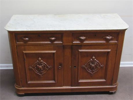 ANTIQUE MARBLE TOP BUFFET ON CASTERS