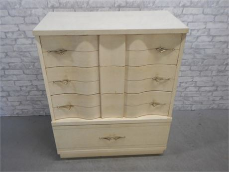 MID CENTURY BLONDE SERPENTINE FRONT CHEST OF DRAWERS