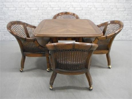 PEDESTAL GAME TABLE WITH 4 CANE-BACK CHAIRS ON CASTERS