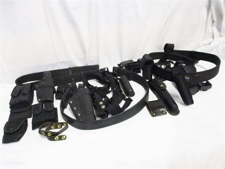 LOT OF HOLSTERS AND ACCESSORIES FEATURING UNCLE MIKE'S