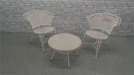 White metal patio chairs and table