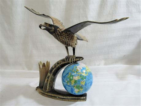 CARVED HORN EAGLE FIGURINE WITH GLOBE