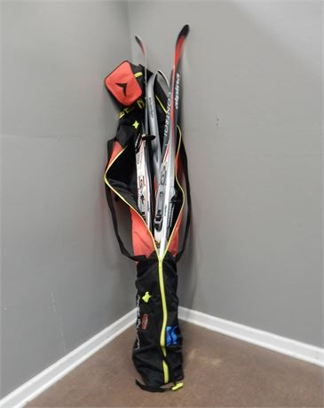 Three Sets of Alpina Skis, Ski Poles and Carrier