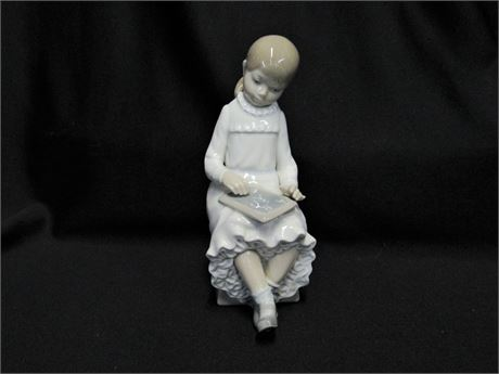 Nao by Lladro - School Girl with Chalkboard Figurine
