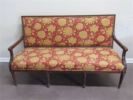 VINTAGE SETTEE WITH FLORAL FABRIC AND WOOD TRIM
