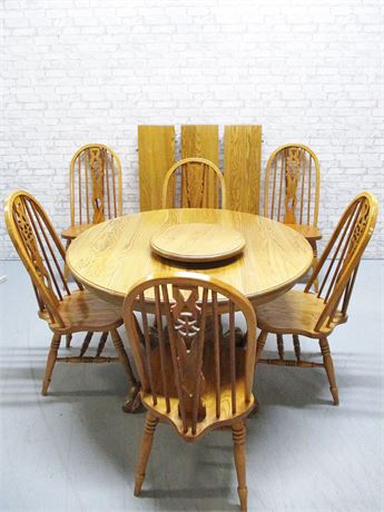 OAK PEDESTAL DINING TABLE WITH 6 KEYHOLE CHAIRS AND 3 LEAVES
