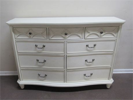 AMERICAN SIGNATURE BOW FRONT ANTIQUED WHITE  9 DRAWER DRESSER