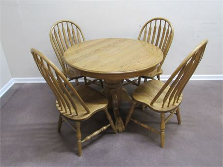OAK CLAW FOOT DINETTE TABLE WITH 4 CHAIRS AND 2 LEAVES