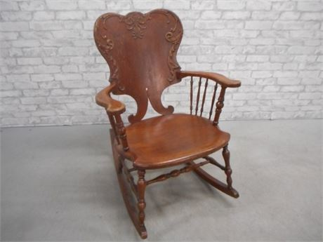 ANTIQUE ROCKING CHAIR WITH UNIQUE LARGE CARVED SPLAT BACK