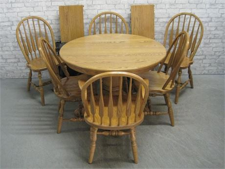 OAK CLAW FOOT PEDESTAL DINING TABLE WITH 6 ARROW-BACK WINDSOR CHAIRS