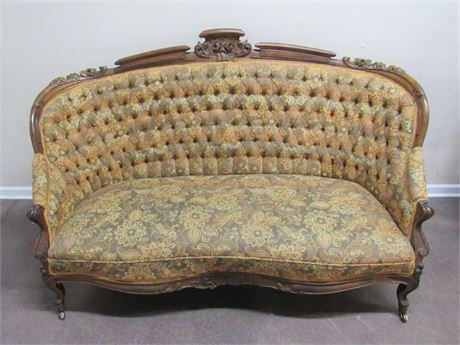 GORGEOUS ANTIQUE TUFTED CURVED BACK SOFA - BEAUTIFUL CARVED WOOD DETAILING.