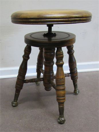ANTIQUE PIANO STOOL WITH BRASS AND GLASS BALL FEET