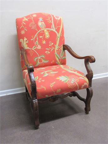 COLORFUL LARGE SIDE CHAIR WITH CARVED TRIM/WOOD ARMS